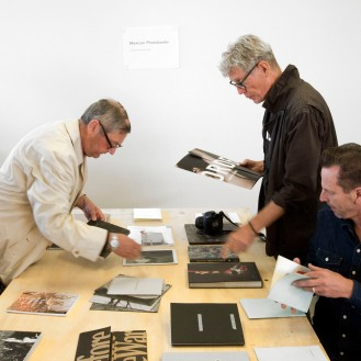 Ron Brownson, Harvey Benge and Mark Purdom viewing Ana Paula Estrada's Mexican Photobook exhibition